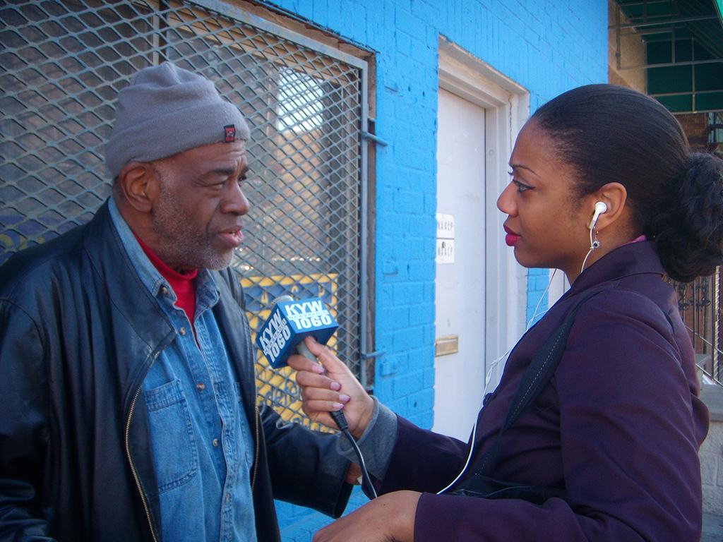 Woman interviewing man with microphone